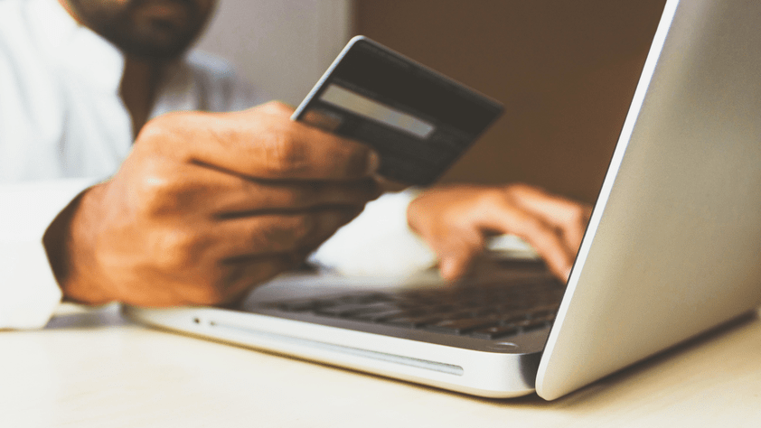 laptop and credit card for online purchases