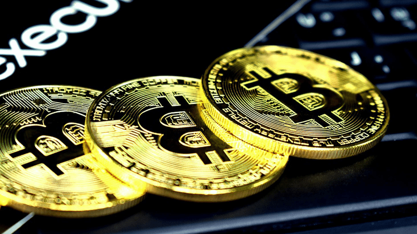bitcoin and litecoin piles on a table