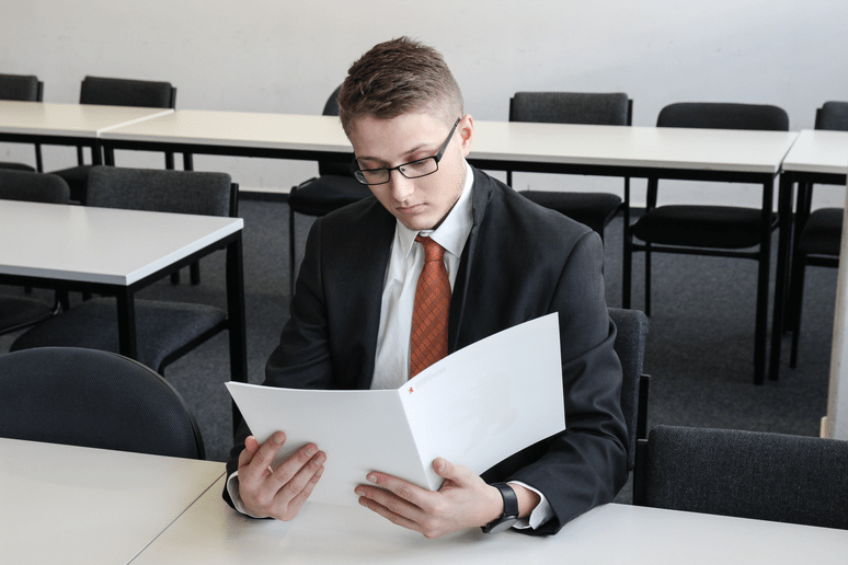 accountant with heavy folders
